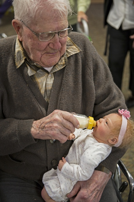 Art and Documentary Photography - Loading Senior Feeding Baby.jpg